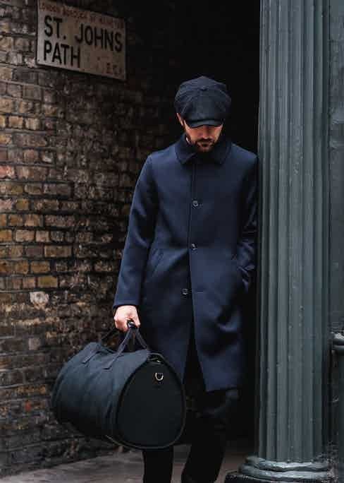 The black holdall perfectly complements an outfit with a dark palette.
