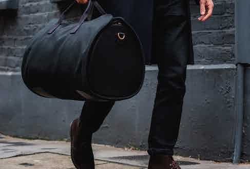 The suit carrier wraps neatly, discreetly and securely around the spacious internal holdall.