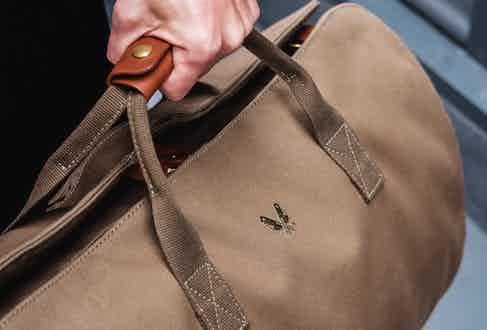 A soft but strong leather grip ensures the holdall is a comfortable carry even when full.