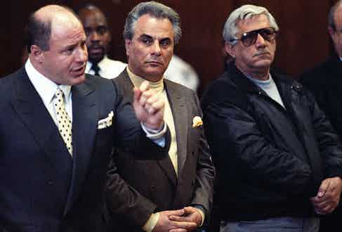 Gotti pictured matching a pale lemon rollneck sweater with his pocket square in a single-breasted suit (Getty).