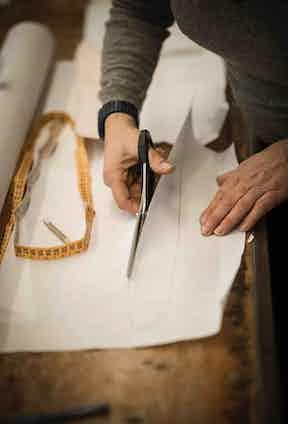 A shirt pattern being cut.