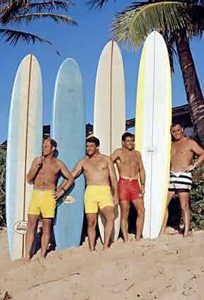 """A group of young surfers photographed by LeRoy Grannis, dubbed """"the godfather of surfphotography"""", on Sunset Beach, 1968."""
