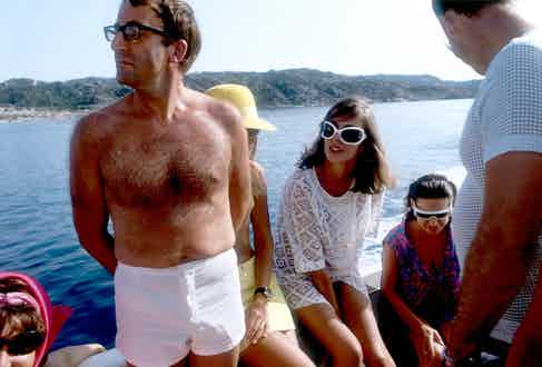 Comedian Peter Sellers wears white swimming shorts while on holiday with Princess Margaret on the Aga Khan's yacht on the Costa Esmerelda, 1965.