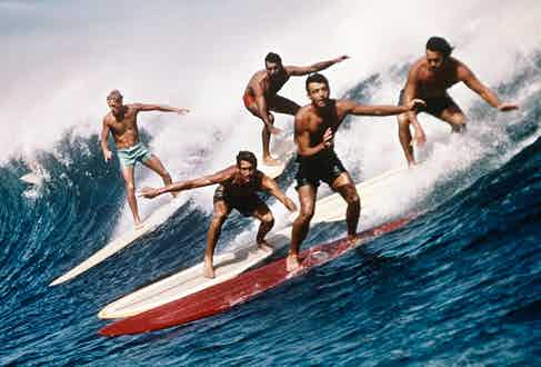 Surf culture influenced the design of swimming trunks, demonstrated here by surfers in 1960 making use of the practical swimwear on offer.