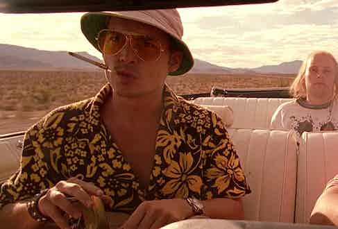 As Raoul Duke in the adaptation of Hunter S. Thompson's novel Fear and Loathing in Las Vegas, Johnny Depp wears a Hawaiian shirt, aviator sunglasses and a bucket hat, 1998.