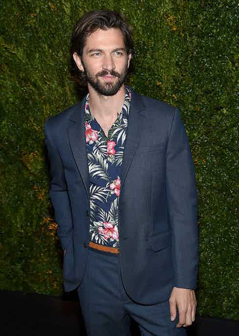 Michiel Huisman attends the Chanel Dinner during the 2015 Tribeca Film Festival in a Jack Wills navy single-breasted suit and a Haspel Hawaiian shirt.