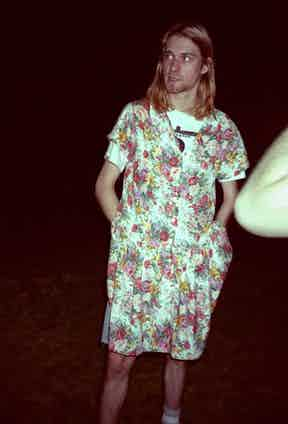 Kurt Cobain dons a floral tea dress during peak grunge, 1993.
