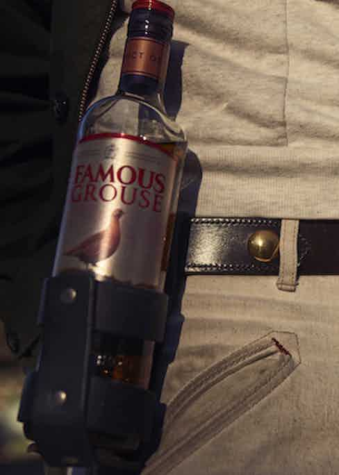 """This innovative piece of kit is a bespoke creation by Nick, which he had made in Wales """"for rugby matches"""" — it's designed to hold a can of beer, or, indeed, a bottle of whisky. His belt is by his now-extinct eponymous brand and is made from tough bridle leather."""