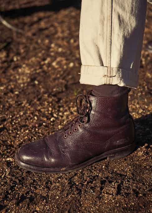 Handcrafted by Cheaney in the style of a WWI field boot, this pair is made from a 'dark walnut' grain leather, features Private White's signature copper hardware, and is versatile enough to wear with casualwear or tailoring.
