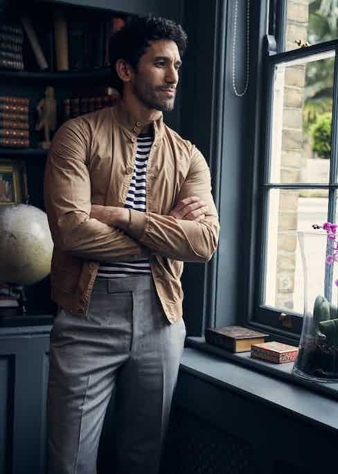 Avena beige cotton jacket, Valstar; striped long-sleeve T-shirt and light grey wool trousers, Anderson & Sheppard. Styling by Jo Grzeszczuk, photograph by Olivier Barjolle.