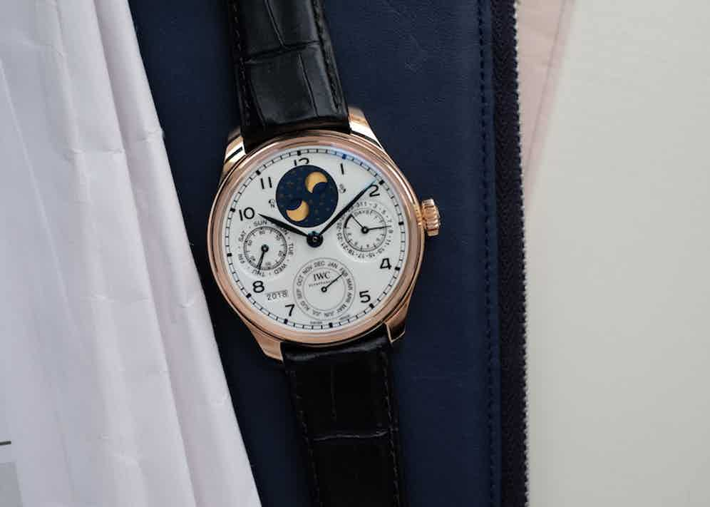 """ThePortugieser Perpetual Calendar Edition """"150 Years"""" is housed in a 44.2mm 18-carat red gold case, white dial with lacquered finish and blued hands. The watch is powered by the IWC-manufactured 52615 calibre with Pellaton winding device which generates a power reserve of seven days."""