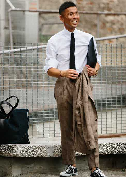 If there is a rule of thumb governing sneakers and suits, it is to coordinate the colours throughout your outfit.