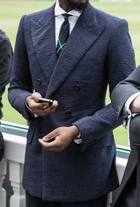 Bespoke tailor Michael Browne wearing a navy on navy double-breasted seersucker suit.