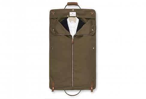 The suit-carrier attachment neatly preserves one suit and one shirt.