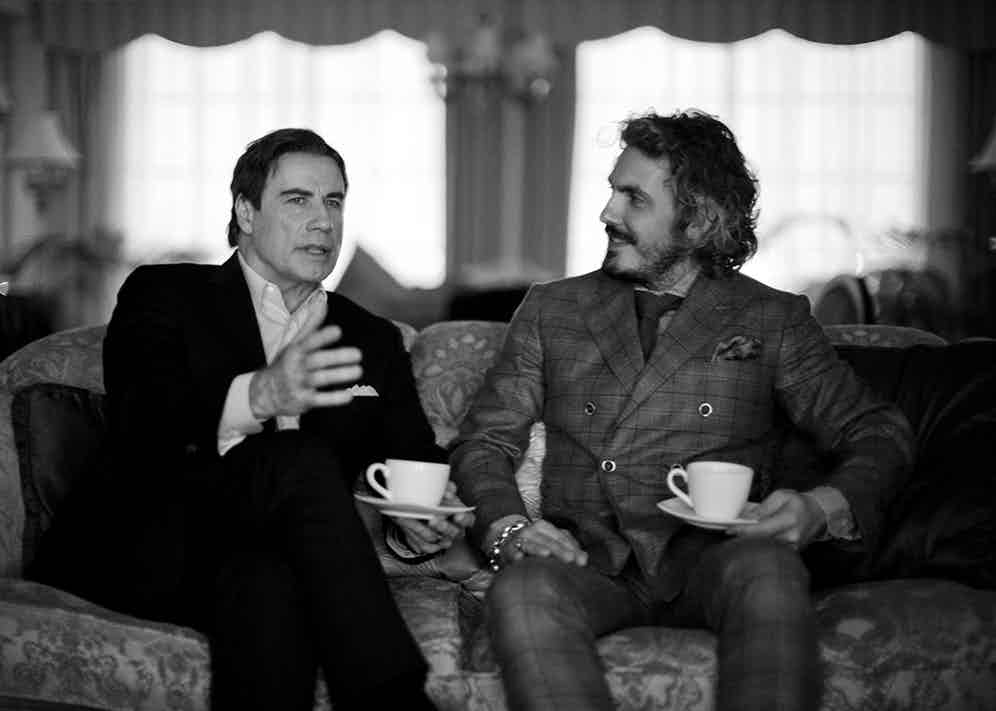 Travolta and Perin in discussion on the intricacies of bespoke tailoring (Thorsten Overgaard).