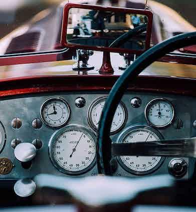 The stylish dashboard on a vintage car.