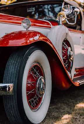 The two-tone exterior of a classic automobile.