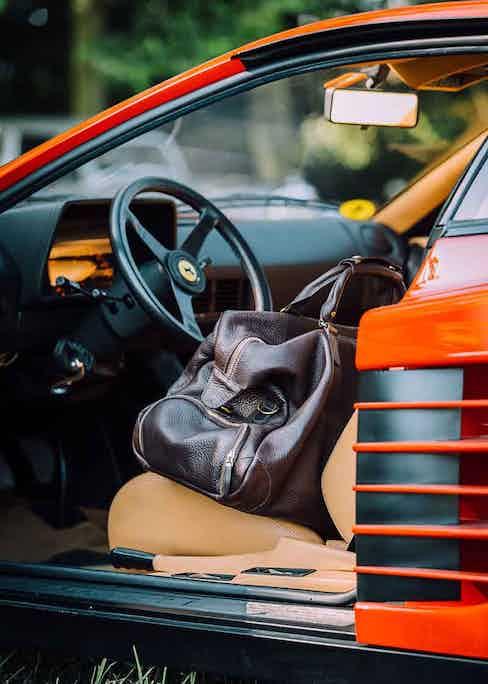A peak at the interior of The Rake's Ambassador, Alain Gafundi, vintage 1990 Ferrari in classic red.