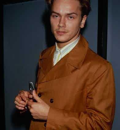 Phoenix wears a tan-coloured jacket, 1991.