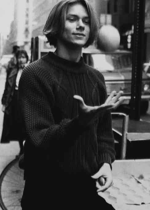 Phoenix wears a cable knit sweater in New York, circa 1990s. Photograph by John Roca