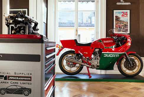 A red and green classic Ducati motorbike.