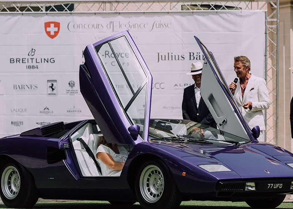 Simon inspecting a purple Lamborghini Countach.