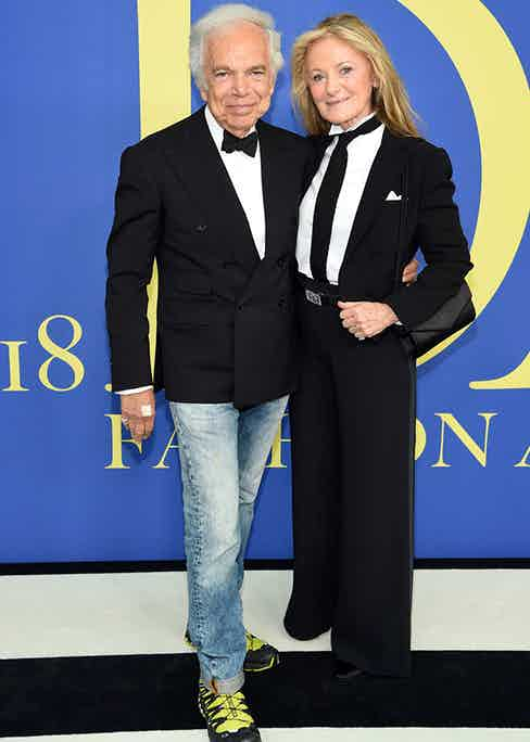 Ripping up the rule book, Mr Lauren, pictured with his wife Ricky, sported black tie from the waist up and faded jeans and hiking sneakers from the waist down. (Getty Images)