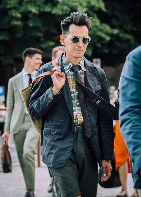A patterned shirt and tie combo worn with shorts by Johann Selles of Sage Shop at Pitti Uomo 94.