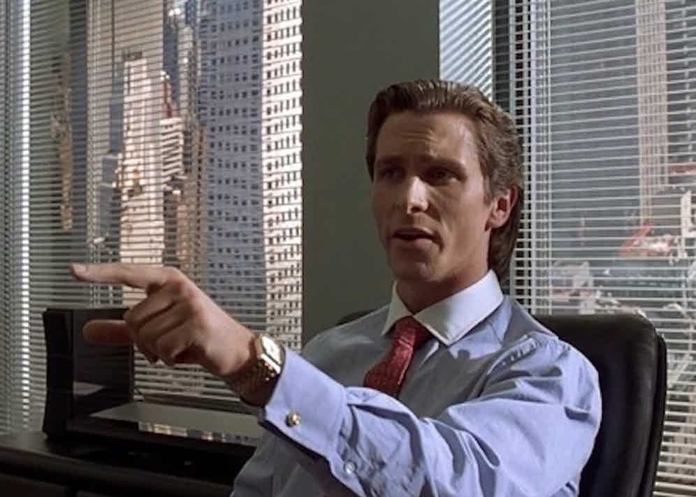 Christian Bale as Patick Bateman in the seminal movie American Psycho (2000) wears a neat set of gold cufflinks with his constrast collar shirt.