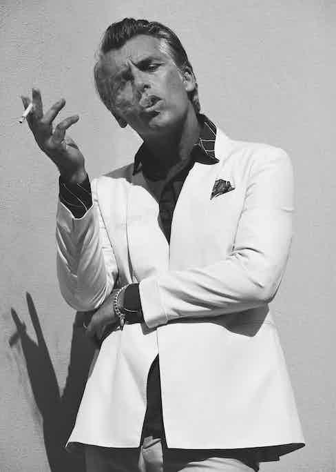 Cream silk double-breasted, shawl lapel jacket, Lardini; burgundy cotton chain print shirt, Hermès; beige cotton trousers, Berluti; brown and vanilla, chianti silk pocket handkerchief, Serà Fine Silk at The Rake.