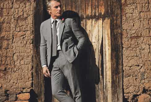 Grey silk and linen two-piece suit with double-breasted jacket, grey cotton flannel shirt and grey silk tie, all Ralph Lauren Purple Label.