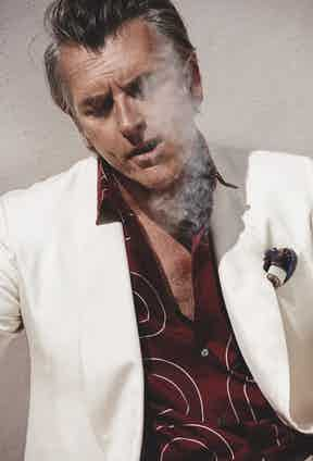 Cream silk double-breasted, shawl lapel jacket, Lardini; burgundy cotton chain print shirt, Hermès; brown and vanilla, chianti silk pocket handkerchief, Serà Fine Silk at The Rake.