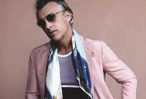Rose pink silk jacket and trousers and white and burgundy stripe cotton tank top, all Ermenegildo Zegna Couture; blue boat print modal and silk scarf, Rubinacci at The Rake; turquoise and gold frame aviator sunglasses, Ray-Ban.