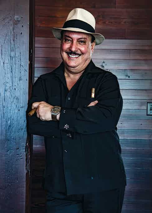 The owner of Arturo Fuente cigars, Carlito Fuente, shot at the Arturo Fuente cigar factory in Tampa, Floria. Photo by Karl-Edwin Guerre.
