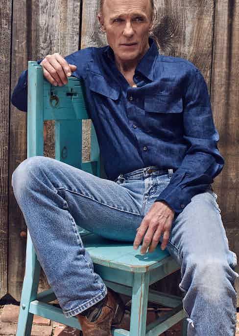 Blue linen safari shirt, Ralph Lauren Purple Label at Harrods. Blue denim jeans and brown leather cowboy boots, both property of Ed Harris.
