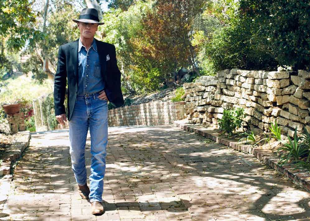 Black linen tuxedo jacket with silk lapels, Ralph Lauren Purple Label at Harrods; sky blue and white linen hand-printed pocket-square, Anderson & Sheppard Haberdashery. Blue denim shirt, blue denim jeans, Earl Grey felt hat and brown leather cowboy boots, all property of Ed Harris.