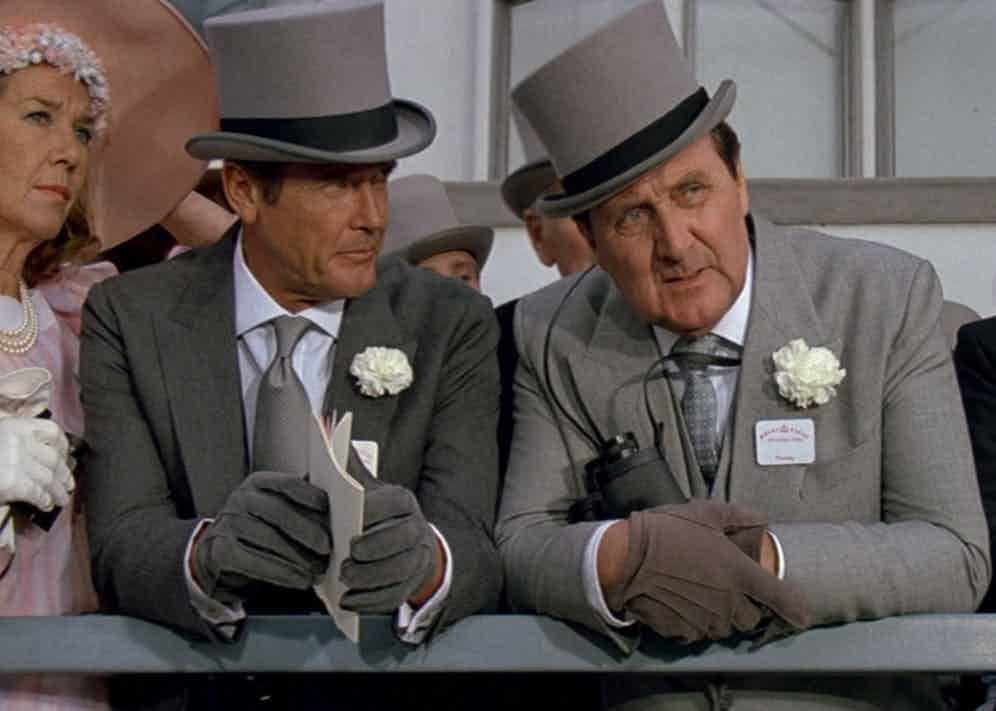 James Bond, played by Roger Moore, and Tibbett wearing grey morning suits at Royal Ascot in A View to a Kill, 1985.