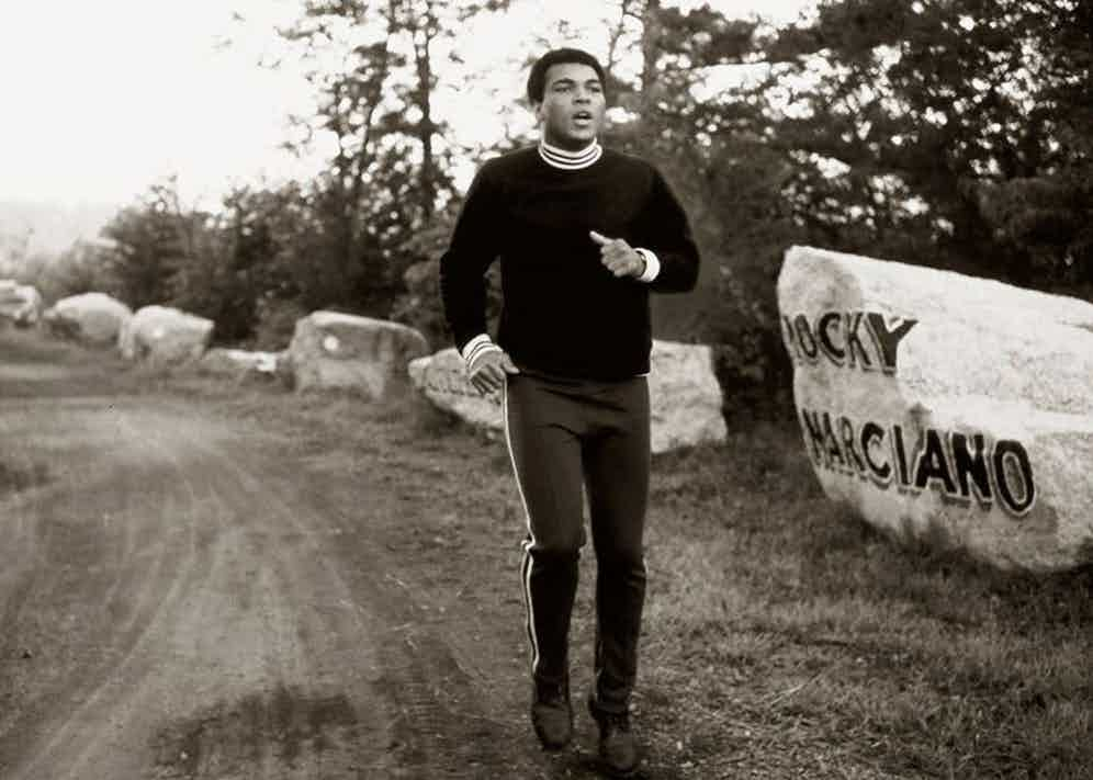 Muhammad Ali hits the road in a pair sweatpants at his training camp in Deer Lake, Pennsylvania.