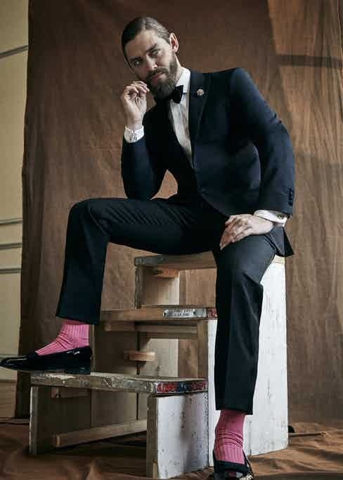 Midnight blue wool and mohair evening suit and black silk bow tie, both Hackett; white cotton evening shirt, Turnbull & Asser; pink cotton socks, Pantherella; black patent leather bow pump dress slippers, George Cleverley.