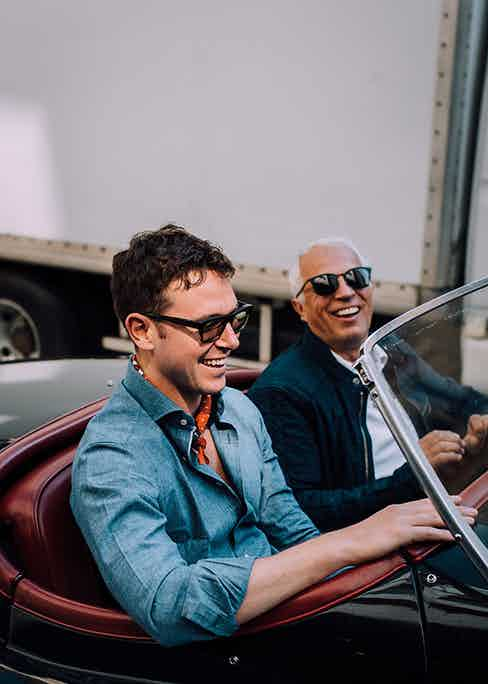 Ryan Thompson and Pascal Guichard share a laugh in the latter's Jaguar XK120.