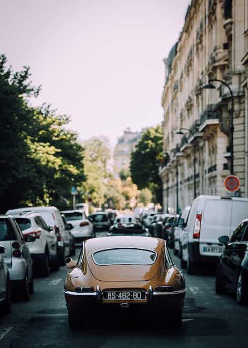 What a backside: the legendary Jaguar E-type strutting its stuff through the backstreets of Paris.