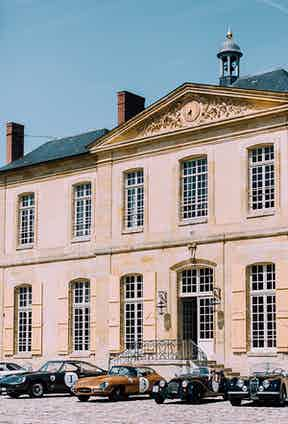 The cavalcade of vintage delights line up outside the Chateau de Villette.