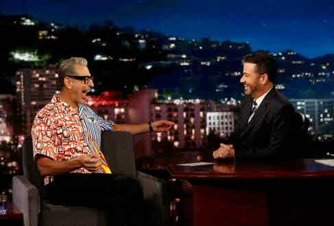 Appearing on Jimmy Kimmel Live in a vibrant printed shirt by Prada in 2018.