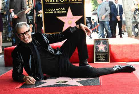 Posing with his star on the Hollywood Walk of Fame, 2018.