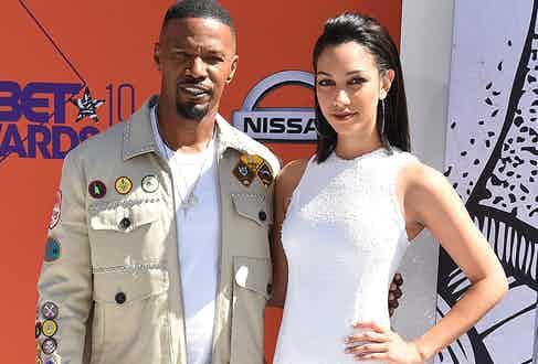 Jamie Foxx pictured with his eldest daughter Corinne, a model and actress and co-presenter on the hit show Beat Shazam (Alamy.
