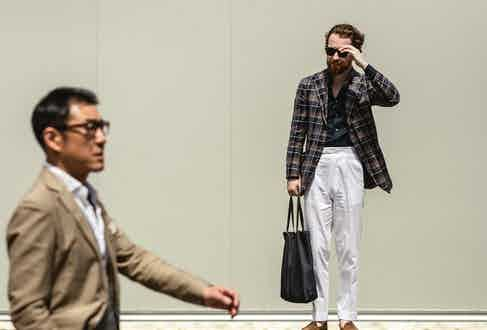 Jim Parker of The Armoury provides no error with a white trouser which meets a navy shirt and checked jacket.