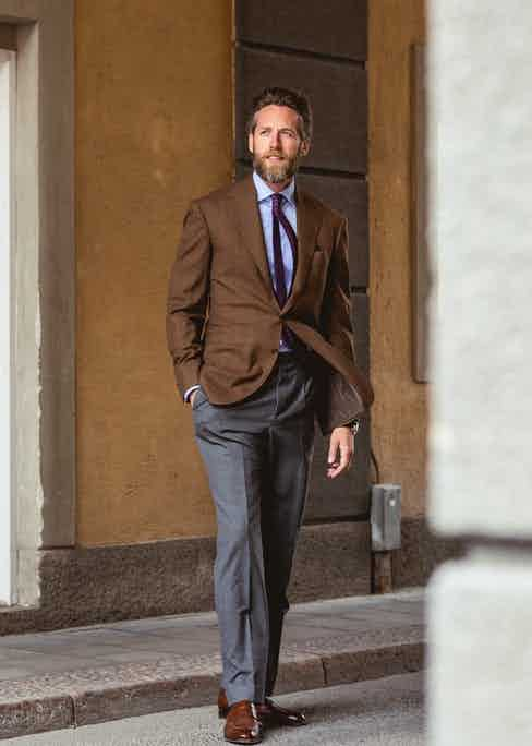 Patrik Löf, co-founder of Skoaktiebolaget, wears a subtle brown windowpane jacket with a simple tailored grey trouser.