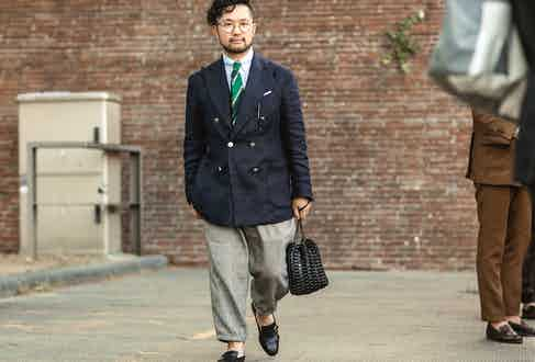 Proportions and fit are clearly understood here with a wide-leg and cropped Prince of Wales flannel trouser with a full cut navy blazer.