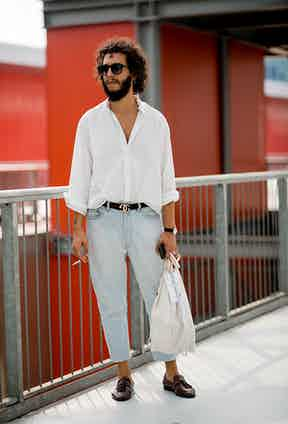 Could you get more sprezzatura? Cropped tapered jean, burgundy tassel loafers and simple white shirt casually tucked at the front to draw attention to the Gucci belt.
