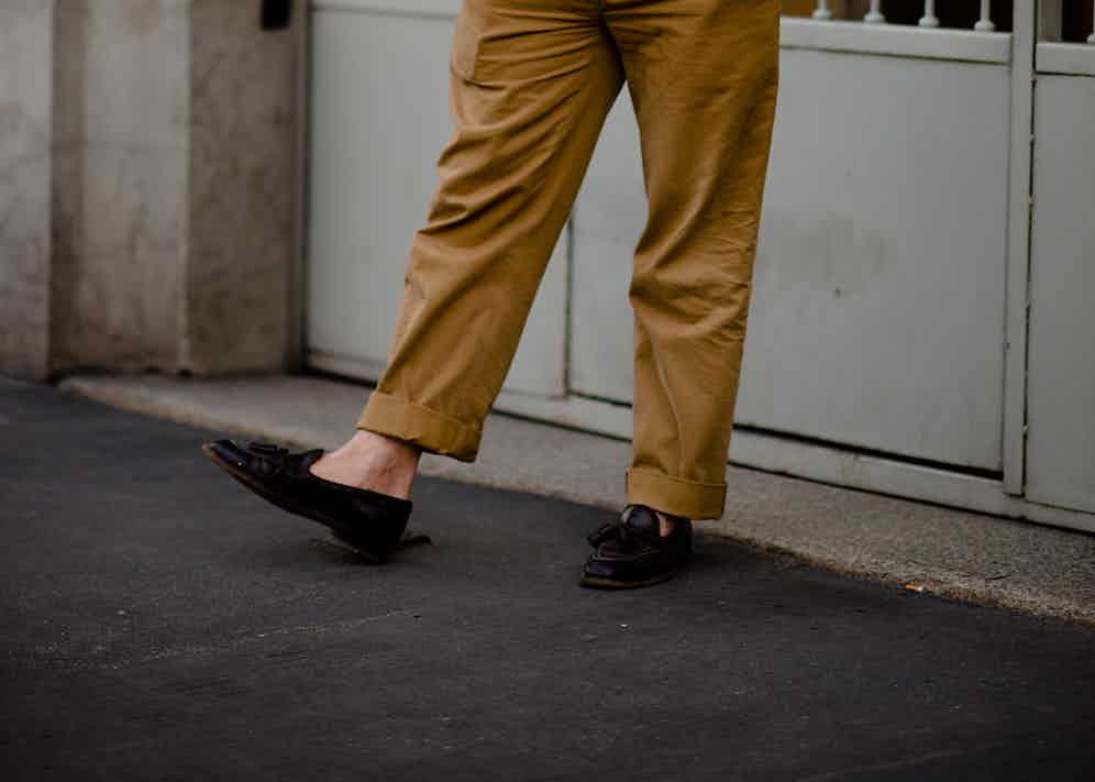 This gentleman has opted for a very slight crop with a large turn-up. On a heavier shoe or boot, these would possibly be the correct length but with a loafer the effect is slightly cropped.